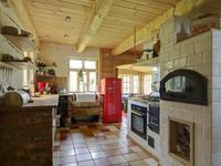 Aranżacja kuchni w domu z bali. Wyjątkowe meble kuchenne